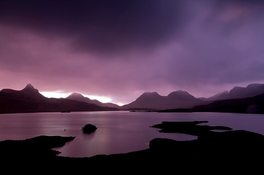 Dawn breaking over Loch Bad a Ghaill, Coigach and Assynt, Scotland. - Photo: Peter Cairns