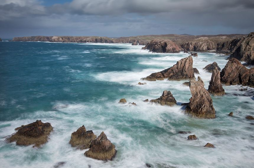 Sea stacks in stormy weather, Isle of Lewis, Scotland. - Photo: Peter Cairns