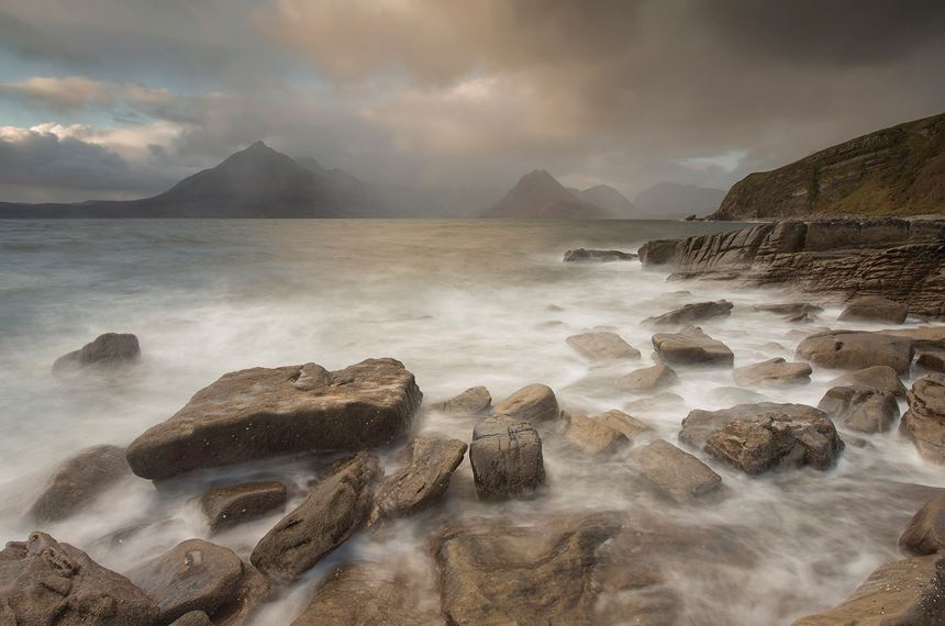 Stormy weather over Cuillin Mountains from Elgol beach, Skye, Scotland. - Photo: Peter Cairns