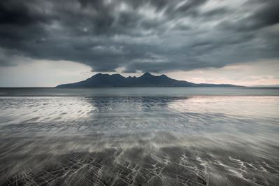 Dynamic light over Rum from Laig Bay, Eigg, Scotland.