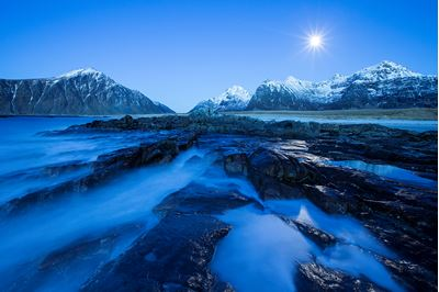 Moonlit seascape in winter, Lofoten, Norway.